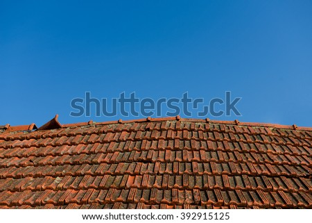 Old ceramic roof with blue sky