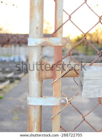 old chain link fence - stock photo