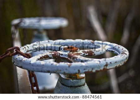 Old Chained water valve - stock photo