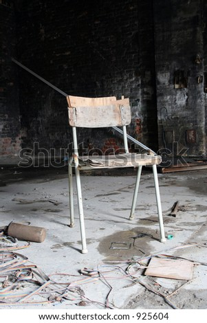 old chair in abandoned factory - stock photo