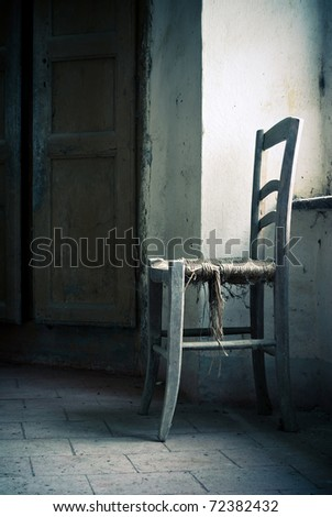 old chair in abandoned place - stock photo