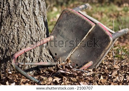 Old Chair in Leaves - stock photo