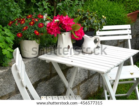 old chair in the garden with flowers