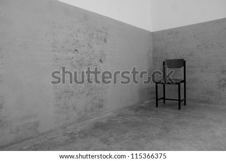 Old chair on crack wall,black and white - stock photo