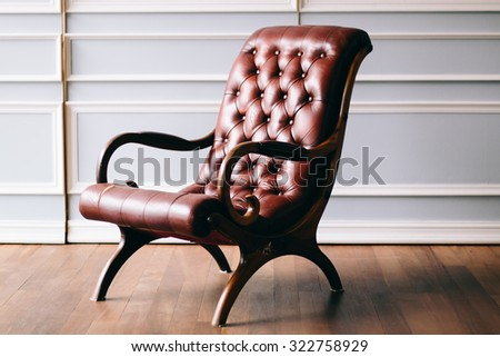 Old chair on vintage background and wooden floor - Vintage grunge empty interior - stock photo