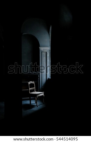 Dark room stock images royalty free images vectors for Chair next to window