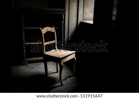 Old chair standing dark room near stock photo 551915647 for Chair next to window