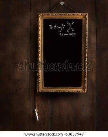 Old chalkboard on wood with copy-space for writing menu - stock photo