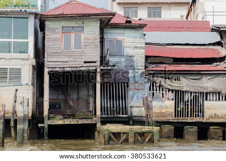Old Chao Phraya River Thai traditional house, village riverfront in Bangkok Thailand.