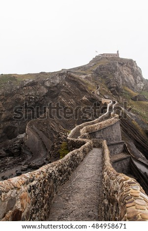 Old chapel on the cliff, by the sea. San Juan de Gaztelugatxe, Basque Country