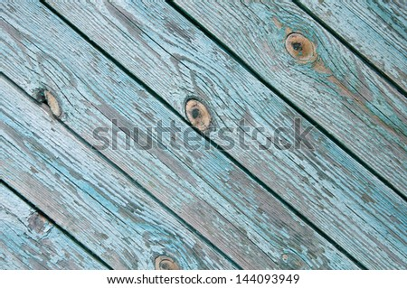 old chapped blue wooden background - stock photo