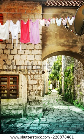 old charming street  in old Europe town - stock photo