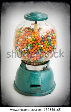 old chewing gum vending machine about 1950 on grunge - stock photo