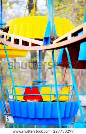 old children's carousel in an abandoned park - stock photo