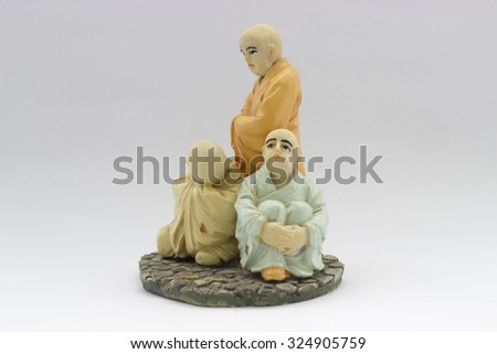 old chinese ceramic young monk doll