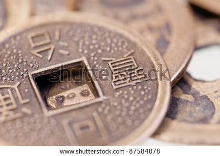 Old chinese coin close up - stock photo