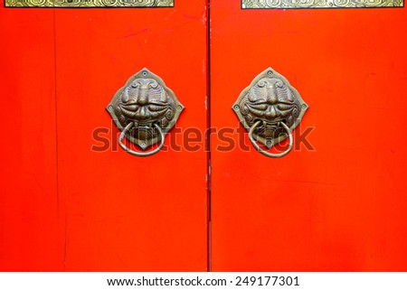 Old chinese door knob in chainese temple - stock photo
