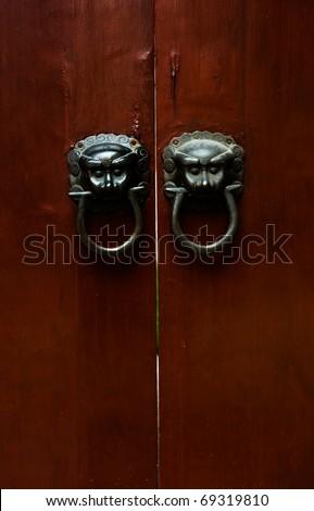 Old chinese door ornament , lion door knockers. - stock photo
