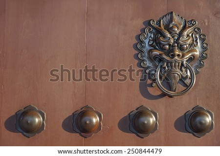 Old chinese lion door knob - stock photo