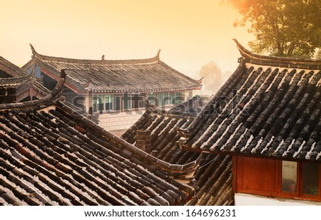 Old Chinese Roofs in rural China at dawn - stock photo