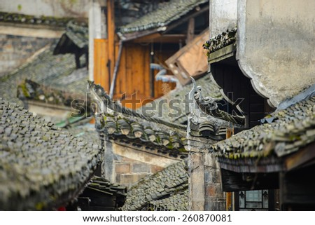 Old chinese rooves in rural china at dawn - stock photo