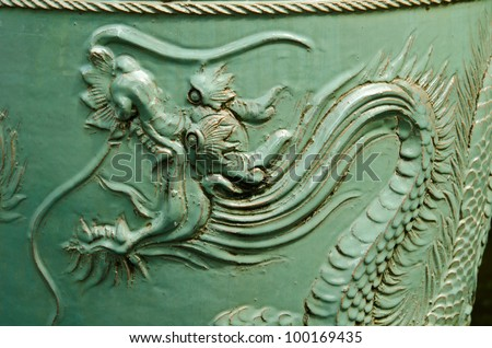 Old Chinese urn with a dragon pattern. Dragon is a sacred animal that Chinese people respect. - stock photo
