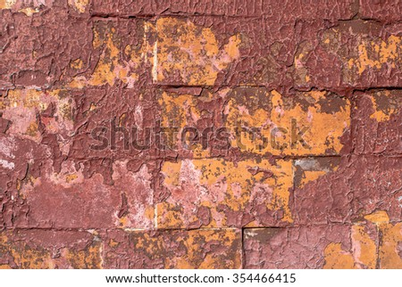 old chipped plaster on the concrete wall texture background