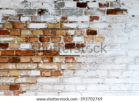 Old chipped white brick wall texture background, whitewashed grungy brick wall with peeling plaster layer, abstract red white vintage background - stock photo