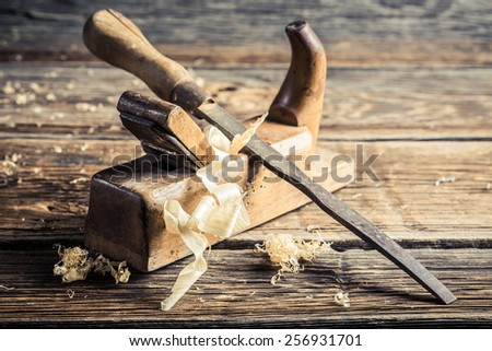 Old chisel and planer in a carpentry workshop - stock photo
