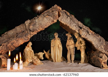 Old christmas manger under a starry night - stock photo