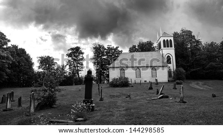 Old Church and tombstones - stock photo