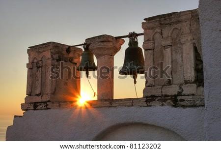 Old church bells at sunset, Oia, Santorini, Greece - stock photo