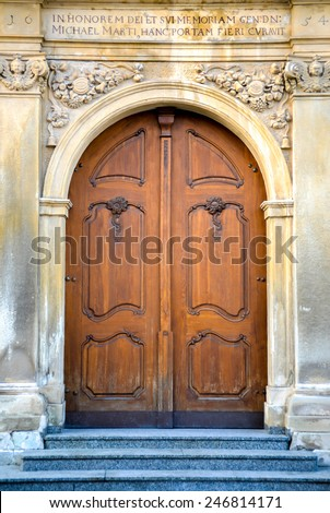 Old church doors in romance style - stock photo
