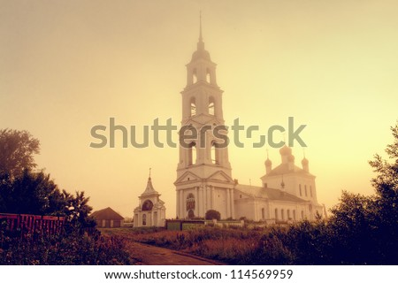 Old church in village with mist at dawn in Russia
