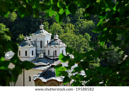 Old church in woods - stock photo