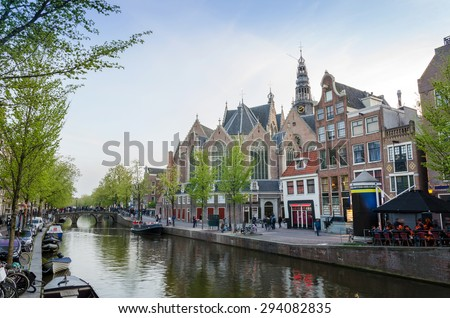 Old Church (Oude Kerk) in main red-light district, Amsterdam, Netherlands. - stock photo