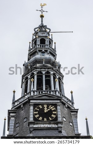 Old Church (Oude Kerk) - the oldest building and oldest parish church, founded in 1213, Amsterdam, Netherlands. It stands in De Wallen, now Amsterdam's main red-light district. - stock photo