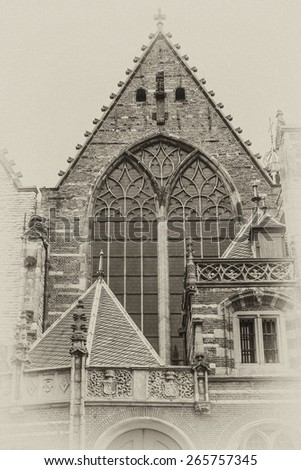 Old Church (Oude Kerk) - the oldest building and oldest parish church, founded in 1213, Amsterdam, Netherlands. It stands in De Wallen, now Amsterdam's main red-light district. Antique vintage. - stock photo