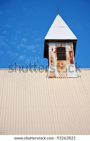 Old Church turret against blue sky - stock photo