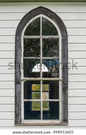 Old church window on white wall