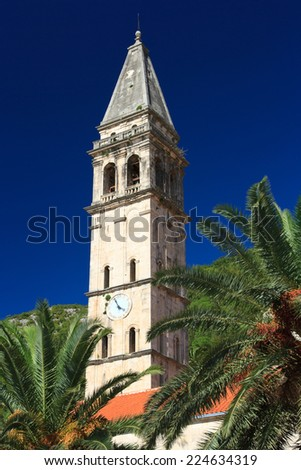 old church with a bell tower in Perast, Montenegro. close-up  - stock photo