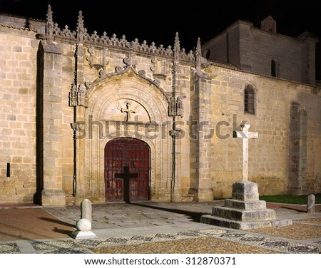 Old church with a centered cross shadow by night - stock photo