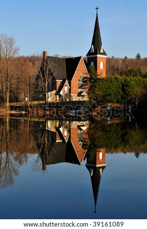 Old church with reflection un lake - stock photo