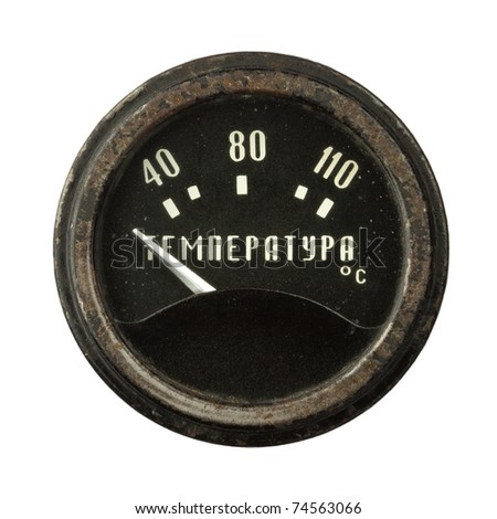 Old circular industrial temperature meter, russian thermometer. - stock photo