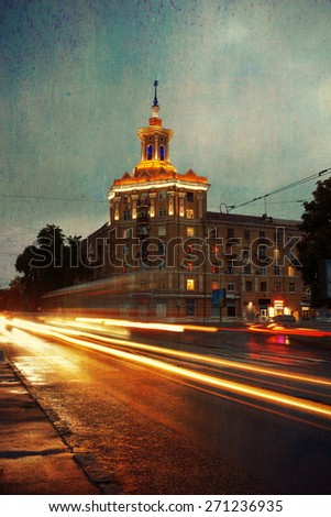 old city at night with moving lights a passing transport - stock photo