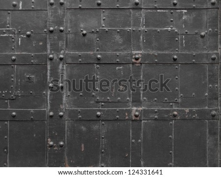 Old city background - Fragment of antique Iron steel door with stack bolts, Vienna, Austria, Central Europe - stock photo