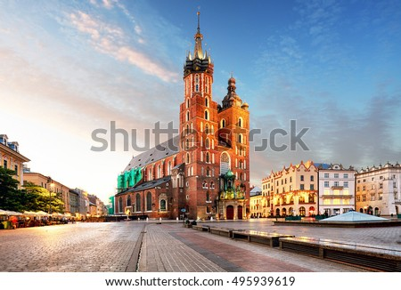 Old city center view with Adam Mickiewicz monument and St. Mary's Basilica in Krakow