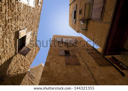 Old city downtown perspective view with blue sky in Saida, Lebanon - stock photo