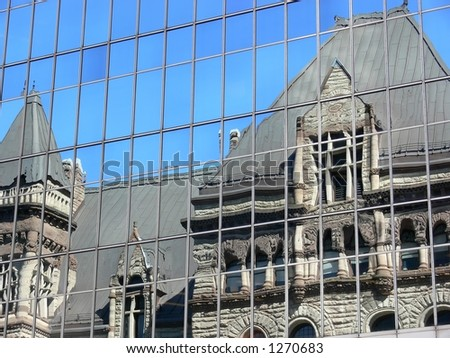 Old City Hall Toronto reflecting in the glass of a neighbouring building.