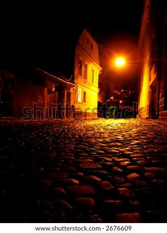Old city in the night - Brasov, Romania - stock photo